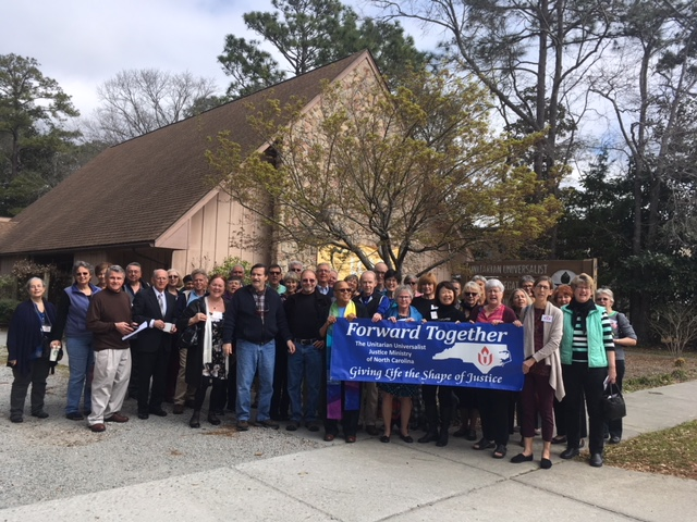 Members of UU Congregation of Wilmington with Forward Together banner